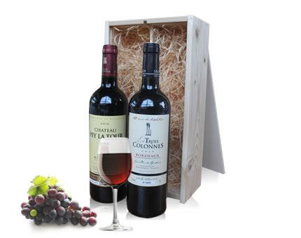 Duo of Bordeaux wine in wooden crate